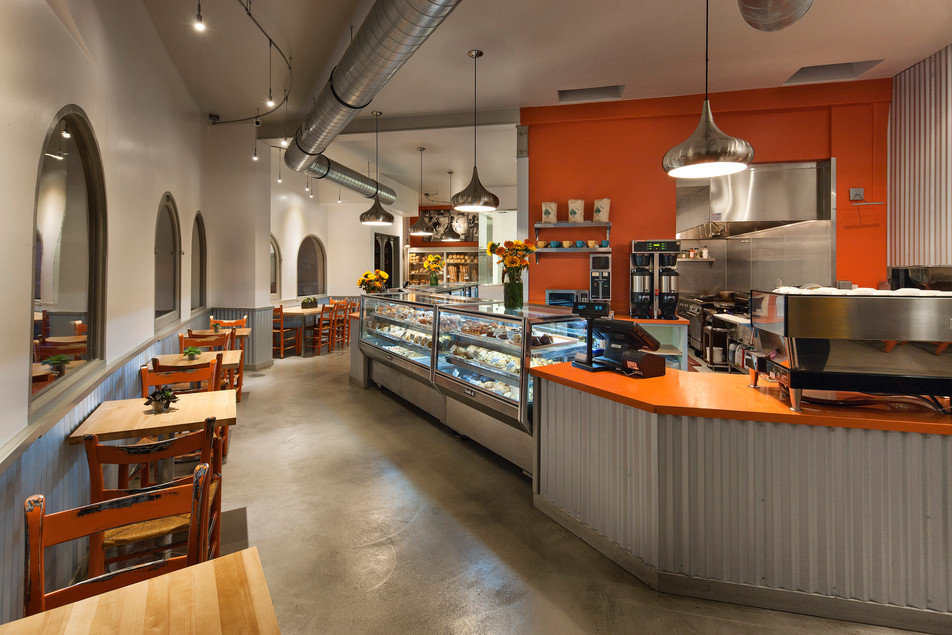 Corner Cafe Bright cheery restaurant design in Santa Barbara with orange accents, concrete floors and galvanized steel