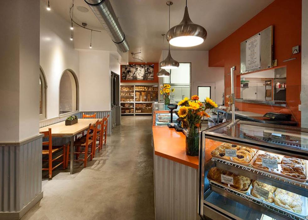 Corner Cafe with orange counter top, modern industrial design