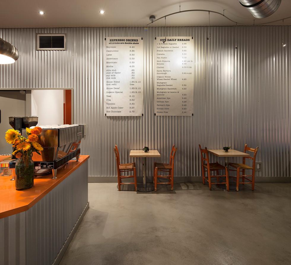 Corner Cafe with galvanized steel accent wall. Modern industrial restaurant interior design