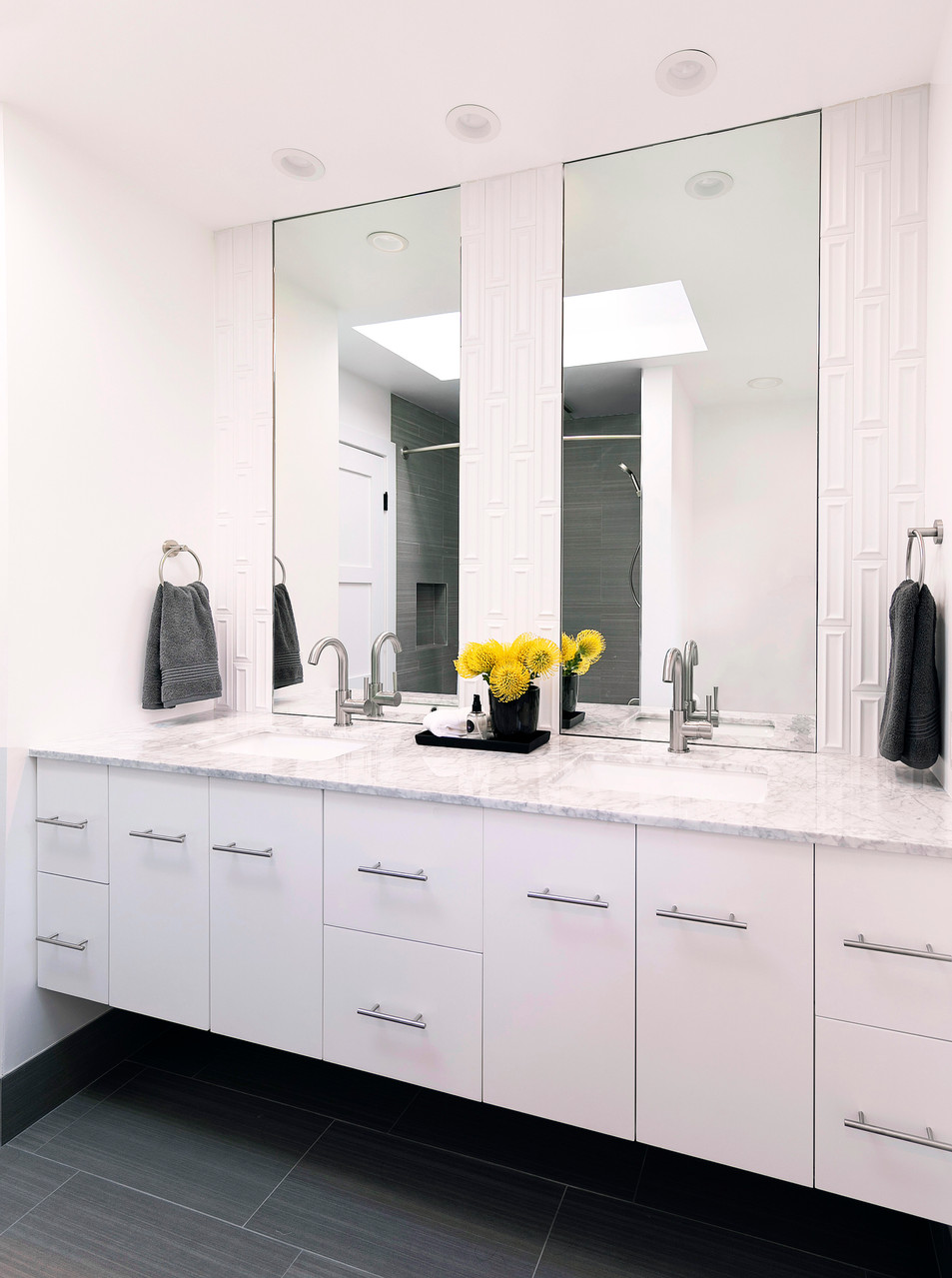 Modern bathroom white floating vanity with inset mirrors and 3-d tile