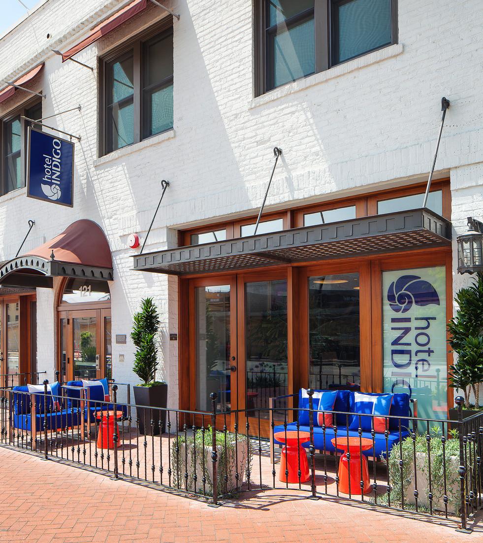 Hotel Indigo Santa Barbara interior design by Keeping Interiors. Front patio with blue and orange furniture