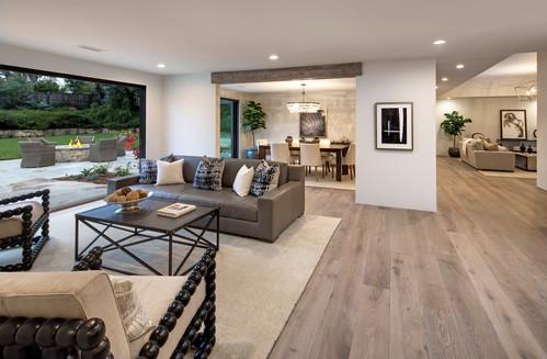 Elegant California Ranch open floorplan living space with wood floors and indoor/outdoor living