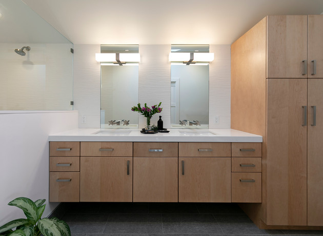 Light wood floating master bathroom vanity and cabinet