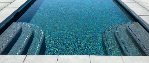 swimming pool with mosaic tile on steps