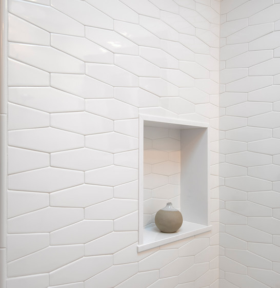 Detail image of modern geometric white shower tile and soap niche