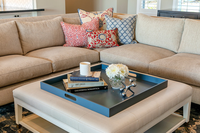 Wine Country Living transitional family room with custom designer sectional, pillows and ottoman with blue tray and accessories