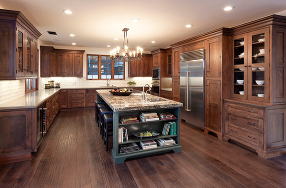 Spanish Mediterranean kitchen with custom wood cabinets, built in china cabinet hutch, painted island with bookshelf, wood floors in Santa Barbara