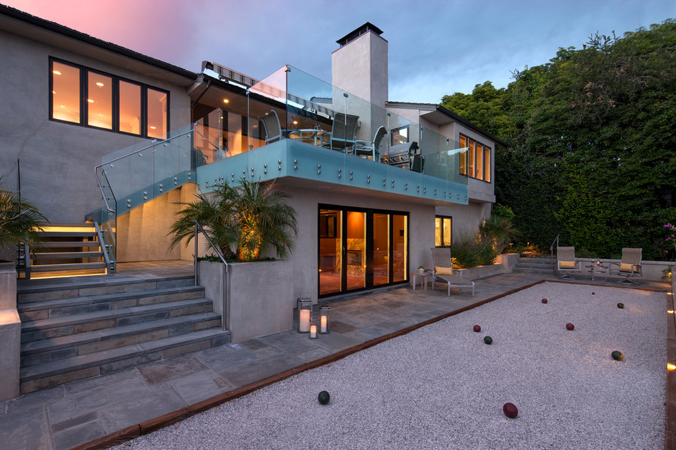 Exterior facade of modern house with upper patio and boccee ball court