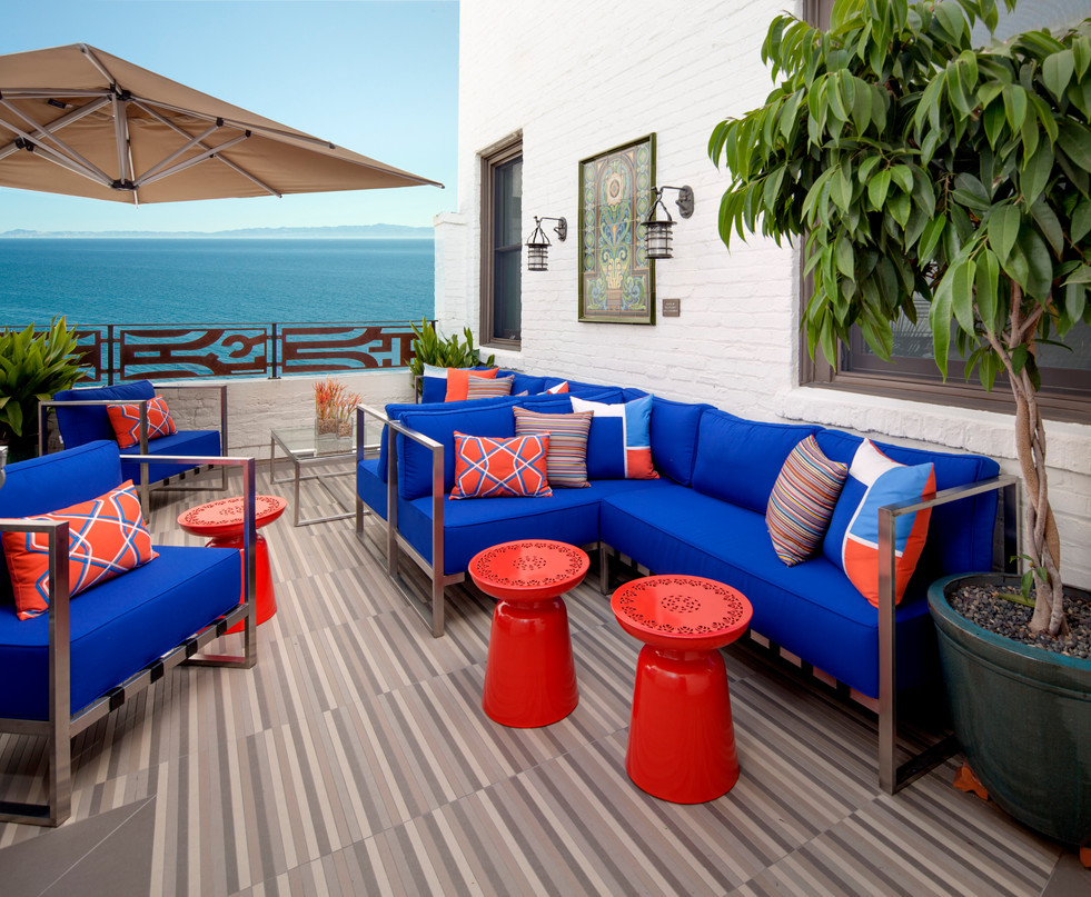 Outdoor patio furniture with blue cushions and orange tables