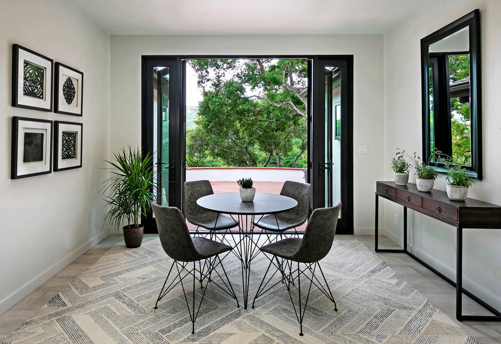 Modern breakfast nook seating area with white walls and french doors. Moden dining furniture.