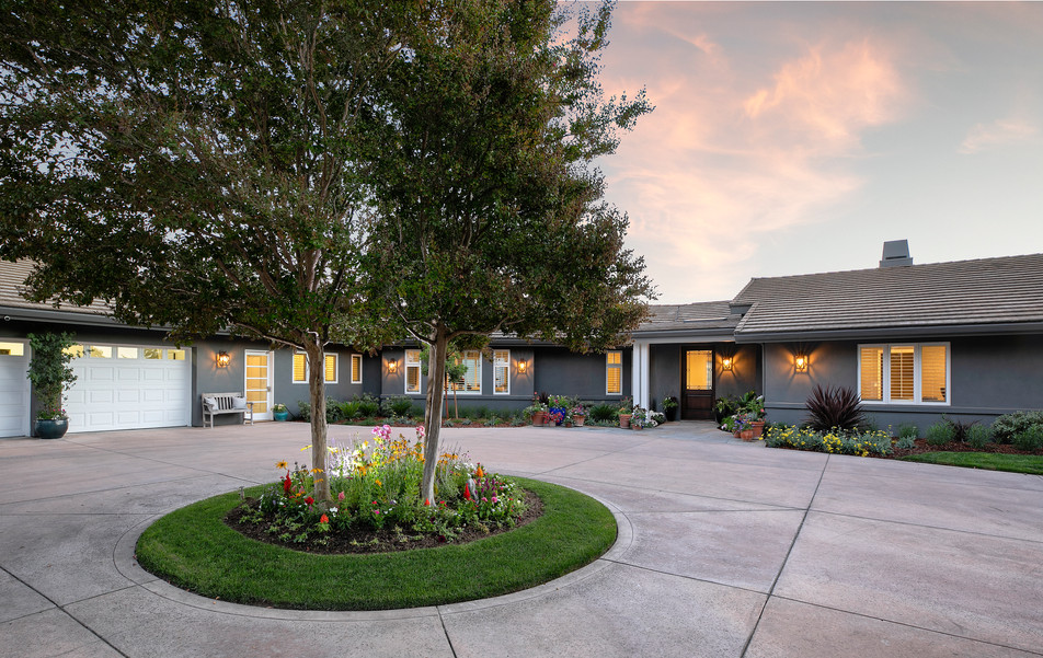 Grey painted stucco ranch style house exterior