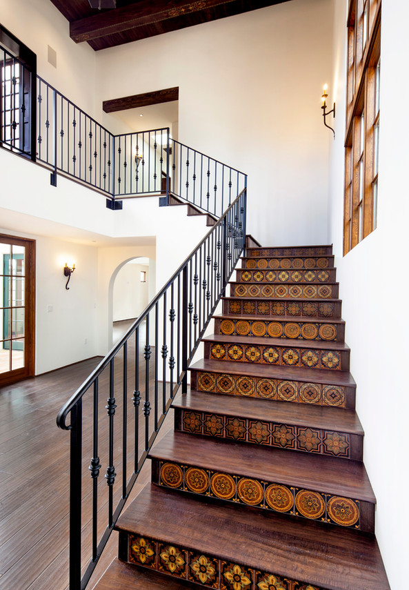 Spanish Mediterranean Elegance stairway with hand painted tile risers, iron railing in Santa Barbara