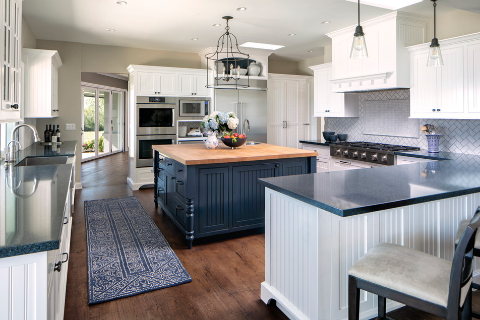 Wine Country Living transitional interior design white kitchen with beadboard cabinets blue painted island and blue counter tops