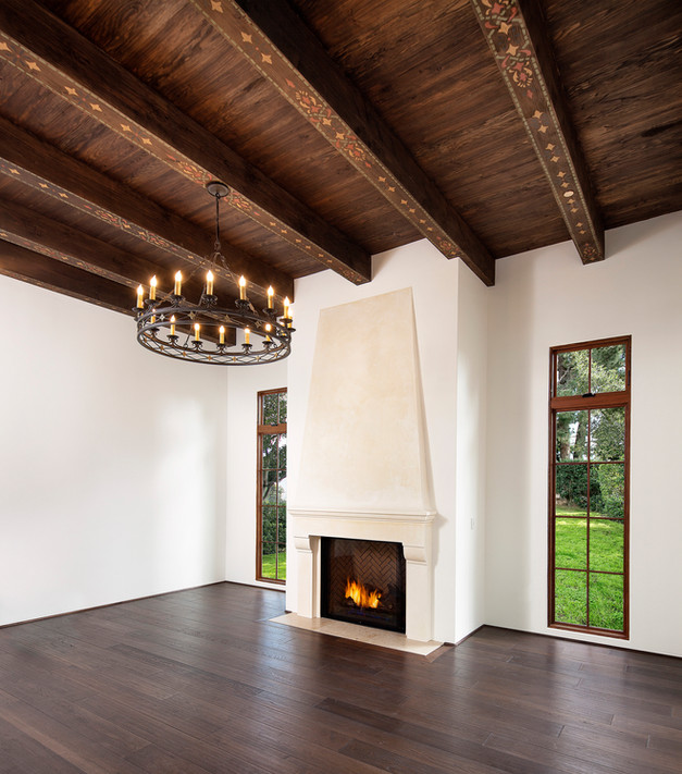Spanish Mediterranean Elegance Plaster fireplace, custom iron chandelier, hand painted wood beams, wood floor