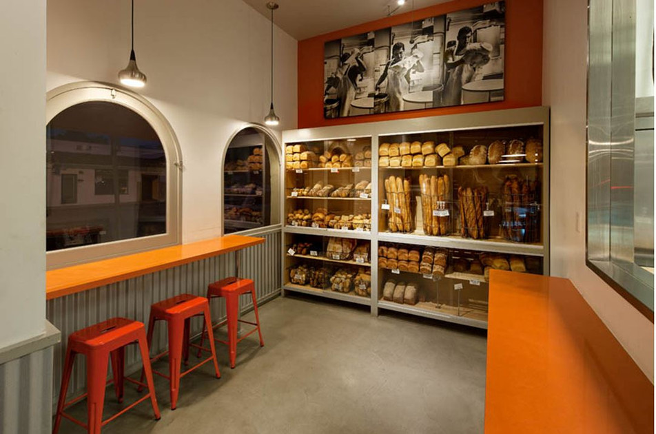 Cafe design with arched windows built-in display in Santa Barbara