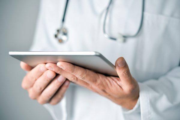Dr. looking at an iPad