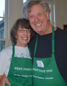 Happy couple with WPI aprons