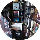 Young woman looking at books in a library