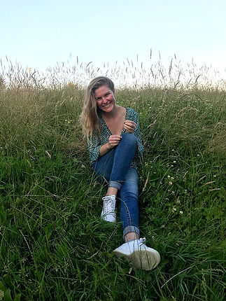 photo of blonde girl in field