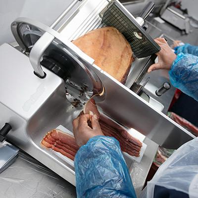 Slicing of Blackforest Ham