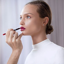Model Applying Lipstick