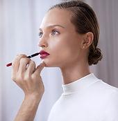 Applying make-up on woman