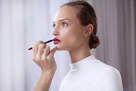 Model Applying Lipstick