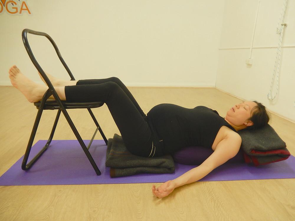 Savasana with legs on chair