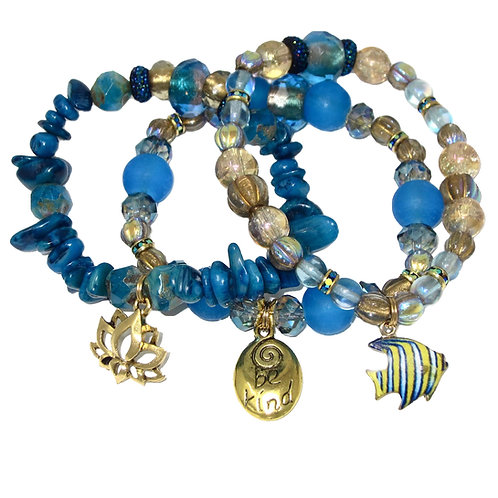 Turquoise and gold Czech glass beads, dyed coral chips, and gold charms