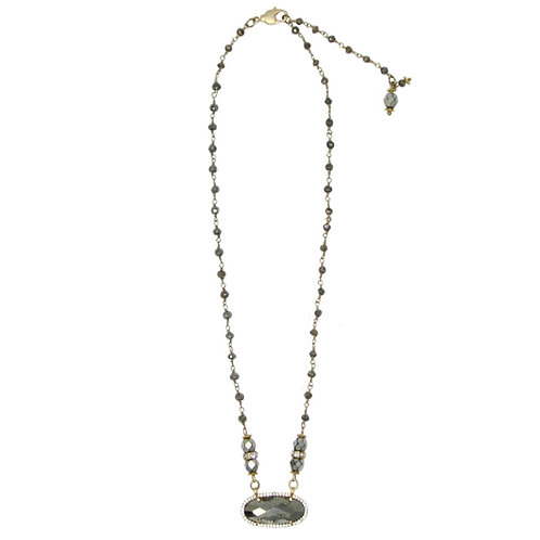 Cubic zirconia pave' faceted hematite pendant and beaded gold chain necklace