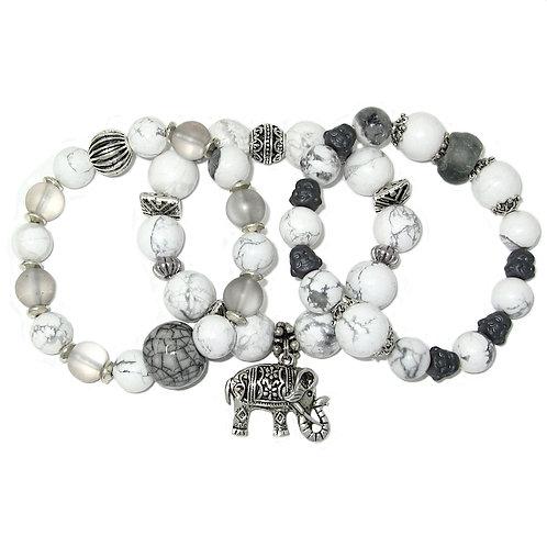 White howlite, African glass, hematite Buddhas, silver elephant charms
