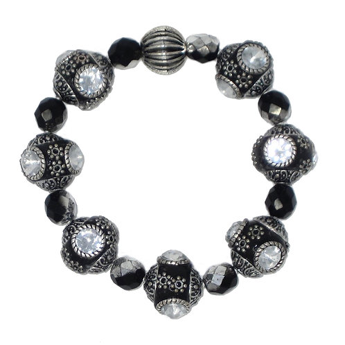 Indonesian rhinestone inset clay beads and Czech glass stretch bracelet