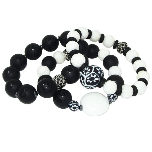 Black/white antique Venetian millefiori beads, carved tridacna shell, black onyx