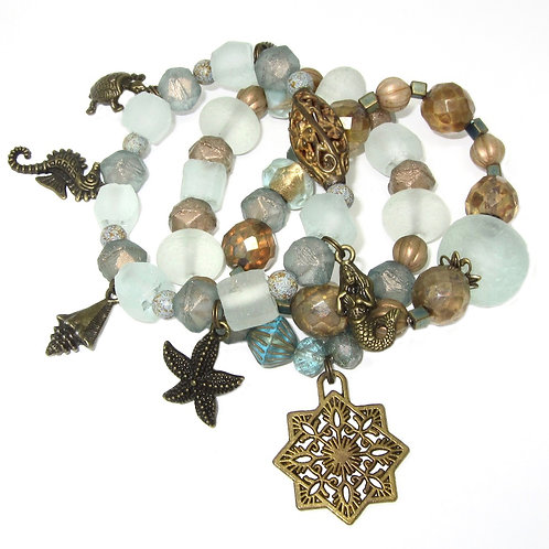 Seafoam African glass, Czech glass beads, filigree brass with sea charms