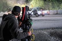 Camera filming car two-way radio rental industry.