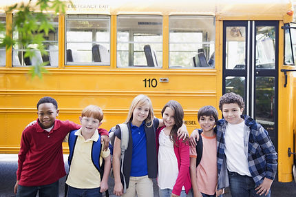 Kids in Front of School Bus
