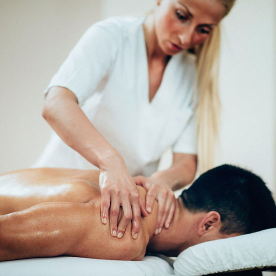 sports-massage-therapist-doing-shoulder-