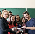 Teacher surrounded by her students in cl