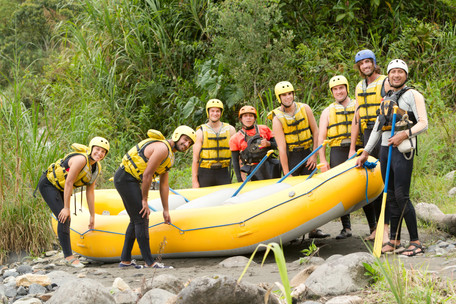LARGE GROUP OF YOUNG PEOPLE READ TO GO RAFTING_