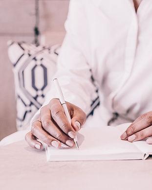 Women writing on her planner