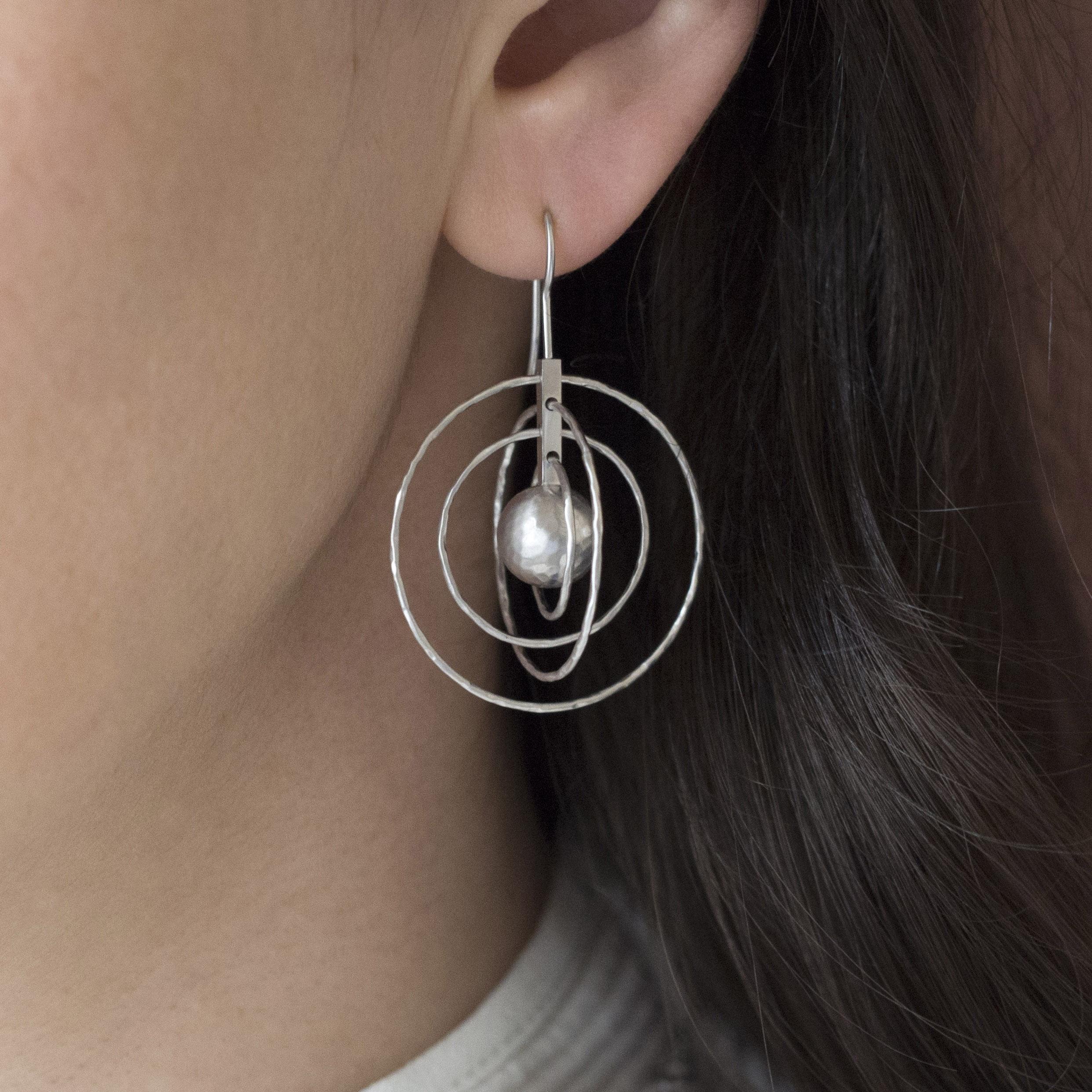 130105-925 crosswind earrings OM d crop