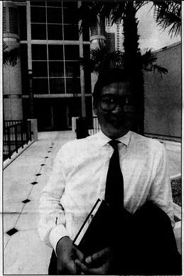 Kha Le-Huu at the entrance to the Harn M