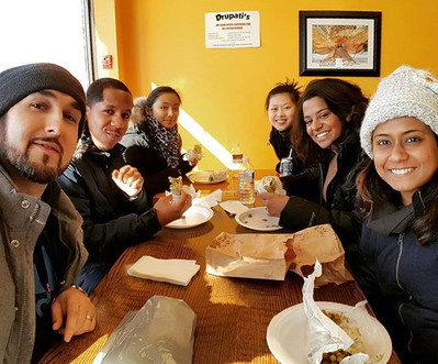 My happy group enjoying amazing Doubles from a local Trinidadian restaurant.