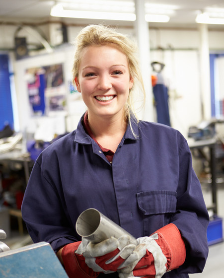 Apprentice Engineer Working On Factory F