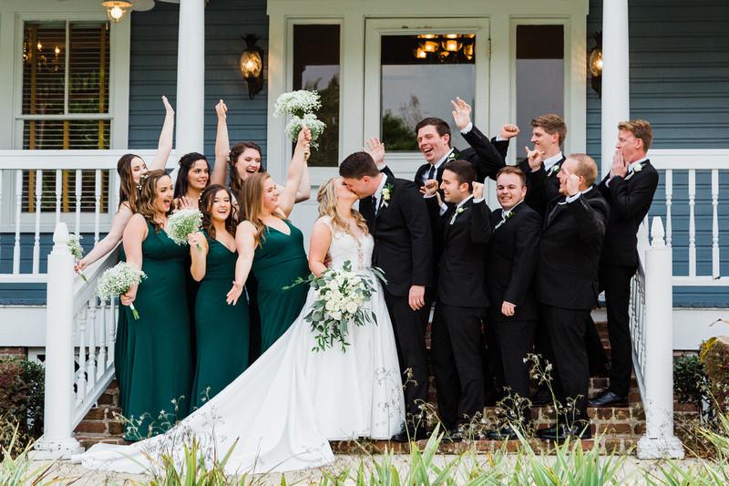 Wedding party photo bride and groom porch Highland Manor