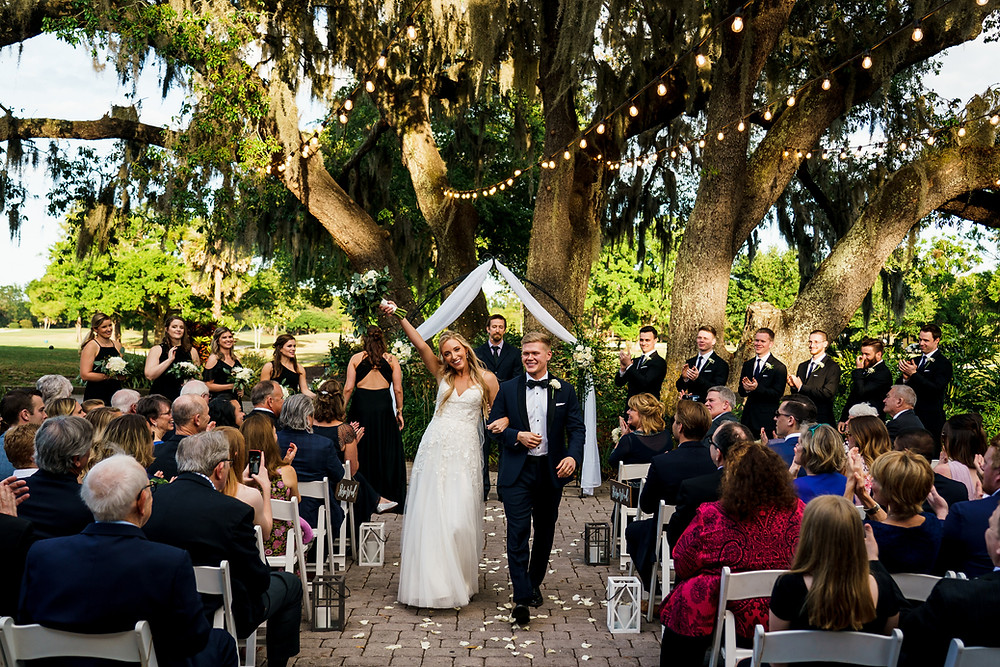 Outdoor wedding ceremony golf course with bride and groom