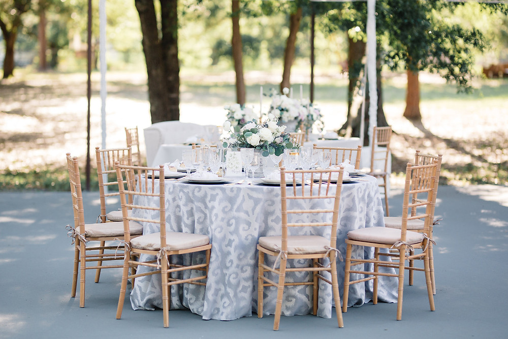Wedding reception table setting under a tent