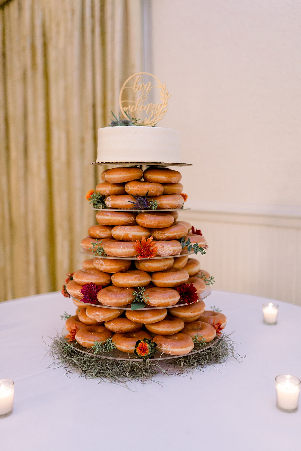 Donut tower with cake at wedding reception