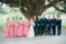 Wedding party at iconic oak tree ceremony site at Highland Manor