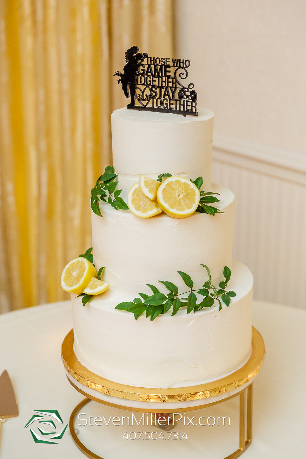 Custom wedding cake greenery lemons white cake topper